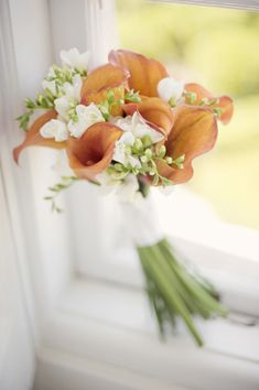burnt orange callas and white freesias (we will supp. with similar flower to freesia as out of season)