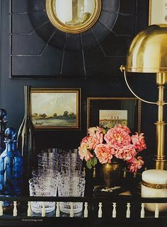 see those pictures? how they have the green, blue and gold? and the gold lamps and mirror as well as the blue jars? imagine that kind of thing in the bathroom. Not navy walls, but subtle hints of things that bring together the two rooms.