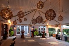 large grapevine balls hanging with outdoor lights by Exclusive Events, Inc.
