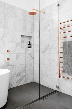 LUXURY BATHROOM IDEAS | marble and copper shower | www.bocadolobo.com