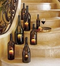 Love this idea for indoors and outdoors - cut the bottom of the bottle off, and place it over a votive candle. Beautiful - especially the brown bottles. Blue would be pretty too!