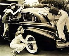 1940s ladies and their wheels! (The Andrews Sisters)  Love the wide pants.