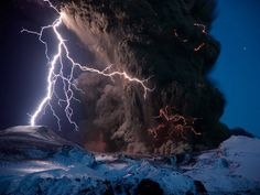 Lightning storm during an eruption of Iceland's Eyjafjallajökull volcano in 2010. This was the same eruption that disrupted air travel for about a week - fortunately for those who were 'trapped' in sunny climbing destinations around europe!    Photograph by Sigurdur H. Stefnisson, National Geographic.