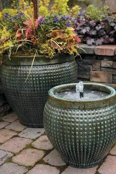 Make a fountain from a pot. So easy! 19 dollar solar fountain from amazon. Pot from Walmart.