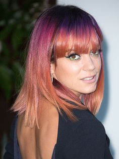 Purple and orange is the new...was her hair black? Recording artist Lily Allen decided to go out in the world looking like her sister gave her head a Crayola swirlie.