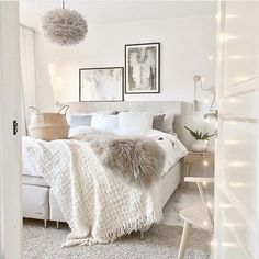 Clean white bedroom with neutral accents using lots of texture such as rugs, faux fur, blankets, woven baskets, unique lighting. Home decor, Home decoring, white bedroom, minimal bedroom, minimal decor, cozy bedroom