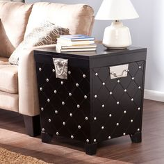 """Longwood Nailhead End Table Trunk, Black/Satin Silver (00037732814414) Longwood Nailhead End Table Trunk, Black/Satin Silver: Offers closed storage and open display space Safety hinges prevent slamming Decorative nailhead and diamond grooved pattern Black painted finish with satin silver accents Tabletop:20""""W x 20""""D Storage: 16.5""""W x 16.5""""D x 17""""H (plus 2.25""""H in lid) Clearance: 13.25""""W x 13.25""""D x 2.75""""H Approximate weight:48 lbs Supports up to: 80 lbs (top), 100 lbs (interior storage) ..."""