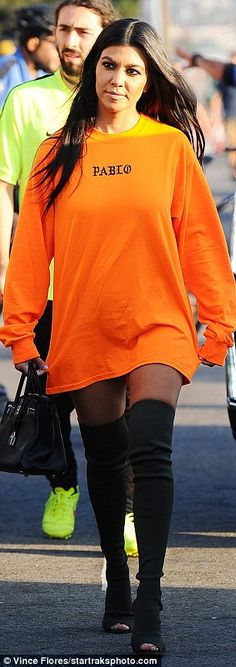 Well heeled: Kylie and her sister Kourtney Kardashian both opted to wear sexy, thigh-high boots