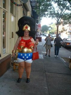 Oh my word.  Is it the white Panties showing or the down pointing gold boobies that let this costume down??OH I know what, it is the orthopaedic shoes lol!!