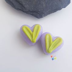 Colour your world 🌈 Cute heart beads set on a pastel purple base, decorated on both sides with raised green hearts. 15x12x9mm approx Love handmade, buy handmade. These are made to order, each pair will be unique. Please allow time for delivery, generally 1-2 weeks.  Pastel Purple, Lampwork Beads, Glass Beads, My Etsy Shop, Jewelry Design, Hearts, Jewelry Making, Delivery, Stud Earrings