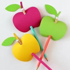 Get the free cut file to make these adorable apple-shaped pencil toppers for back-to-school!