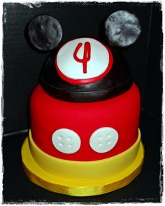MIckey Mouse - Chocolate cake with MacMom's BC Flavored Fondant with candy melts added.  The Mickey hat is styrofoam covered in fondant.  Goes with the Minnie cake I'm about to upload!!!