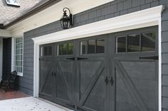 Garage doors with decorative hardware.