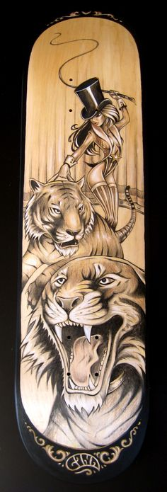Decked Out Skateboard by Gina Kiel, via Behance. A board that combines fierceness and sexiness perfectly. The use of negative space and shading to create the subjects (the tigers and woman) and the background is what makes this board intricate and artisti