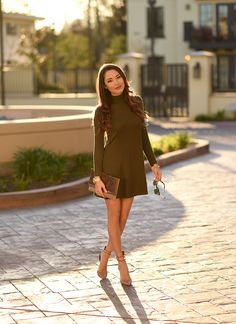 olive green knitted dress with envelope clutch