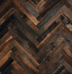 Thin timber parquet panels in a herringbone design