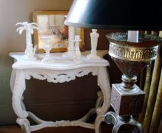 a hideous French reproduction console table that was stained dark brown - it's been painted in china white.