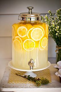 lemonade is an inexpensive drink, and it fits the colors. use other lemons in decoration of tables too? CAKE PLATE!