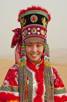 China | Mongol Girl in Traditional Clothes (Model: Zhang Xiaoyan).  Xiangshawan. Inner Mongolia | ©Luis Castañeda.  May 2009.