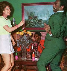 Dancing...gettin' down with my own bad self in my favorite green lady catchin' outfit...i am so cool...dang...