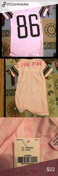 VS Pink Sports Shirt This shirt has never been worn and is NWT, it's labeled as an extra small but I think it can fit up to a large, it's a bigger shirt and very comfortable. I just never got around to wearing it so I figured I would list it for now, but keep if it doesn't sell because the shirt is really great💗💗💗💗 I'm not doing a huge discount because it's brand new never worn. But you can still hit the offer button 😉❤️️👌🏻It's color is closer to the first picture for reference PINK…