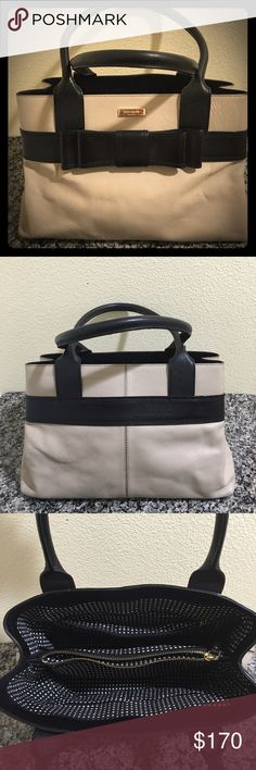 Kate Spade Leather Tan and Black Bag This is such a stunning bag!  The black bow front w/ polka dot lining is the perfect combination.  A couple of minor signs of wear as shown on pics yet barely noticeable.  Measures 15x9. kate spade Bags Shoulder Bags