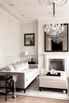 Crown moulding and chandelier with ornate hanging