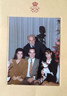 Prince Rainier, Princess Caroline, Prince Albert and Princess Stephanie holding the family dog...