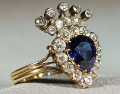 A Victorian Sapphire and Diamond heart and coronet ring.  The faceted Pear shaped Sapphire of good colour, with a surround of 12 old cut brilliant Diamonds with a further 10 Diamonds in the coronet.  All silver set on Gold, to trefoil shoulders and a triple band shank, unmarked 18ct Gold, English, circa 1875 - Sizes:UK: L USA: 5 ¾ Japan: 11 Condition: Good - Item Number: HR 008 - Price: £5,500