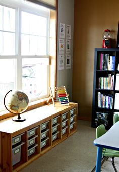 Ikea Trofast Bins Under Window:  We use these to house manipulatives for busy pre-schoolers. Some of our favorites are Magna-Tiles, play food, and stacking pegs. I rotate these toys once in awhile to prevent boredom, but I went ahead and labeled them anyway as many of our favorites tend to stay in rotation.