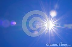 Real Shining sun flare at clear blue sky