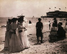 Vintage summer: Pictured in 1900, group of women enjoy summer on New Yorks Coney Island