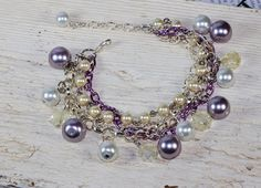 Purple Luster pearl and opalescent Glass bead charm by Soulceen