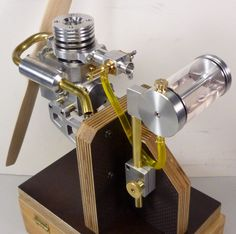A small four-stroke engine with sleeve valve control ready as a display model