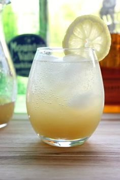 Sparkling Whiskey Gingerade-1/4 ounce by weight fresh, peeled ginger, very finely grated (1 teaspoon) 1 ounce (2 tablespoons) agave 2 ounces (4 tablespoons) fresh lemon juice (from about 2 lemons) 3 ounces (6 tablespoons) bourbon whiskey ice sparkling water