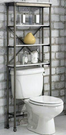 In small bathrooms, an over-the-toilet shelving system is a must. This one's faux marble, open shelves add a touch of luxury, while keeping the bathroom feeling open and airy. Toilet Shelves, Bathroom Shelves Over Toilet, Bathroom Shelf Decor, Bathroom Wall Cabinets, Small Bathroom Vanities, Small Bathroom Storage, Bathroom Furniture, Small Bathrooms, Over Toilet Storage