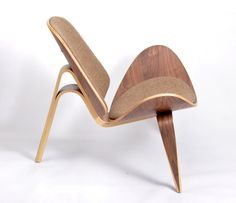 Wegner's Shell Chair - Walnut £797 from Designers Revolt. Original quality designer classics at a fraction of the high street price. Join the Designers Revolt!