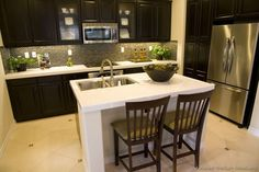 Black Espresso Cabinets With Some Gl Accents Tile And A White Island Kitchen Design Ideas