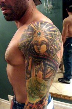 "Joe Rogan's Thai Buddha Tattoo. I like the ""All Seeing Eye"" aspect to it."