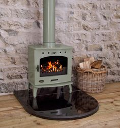 Here at UKAA we sell a vast variety of Carron log burning stoves. Here is a Carron Stove in the beautiful sage green colour. The log burning stove is efficient when burning wood. Wood Stove Hearth, Wood Burner Fireplace, Blue Wood, White Wood, Log Burning Stoves, Wood Burning, Stove Accessories, Multi Fuel Stove, Cast Iron Stove