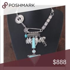 JUST IN 💋 ELEPHANT STATEMENT NECKLACE Super cool necklace in silver tone w faux turquoise.  Great statement necklace w many different charms.  PRICE FIRM UNLESS BUNDLED. BUNDLES OF 3 GET 30% OFF Jewelry Necklaces
