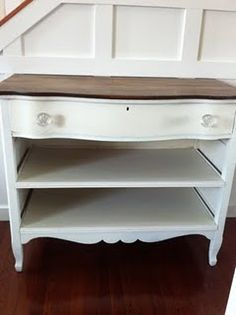 turn a dresser into open shelves and then maybe add some wicker baskets