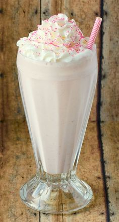 Easy Homemade Strawberry Milkshake Recipe - Just 4 ingredients!! ~ from TheFrugalGirls.com ~ these milkshakes are the seriously most delicious way to cool down on a hot day!
