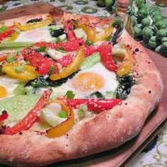 #PizzaTuesday Bok Choy, Baked Egg & Bell Peppers #Pizza: Grated parmesan, sauteed bok choy, scallions, ginger-sauteed red & yellow bell peppers, baked eggs, toasted sesame seeds