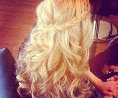 Pretty waterfall braid with curls.
