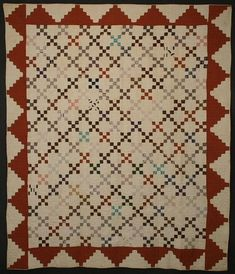 "Nine Patch Quilt: Circa 1870; Pennsylvania  Classic Nine Patch quilt made most unusual by a dramatic stepped border. Beautiful 1870's fabrics. Small scale blocks; each Nine Patch is 3 1/2"" square. Several light brown spots due to the unwashed condition. Strong enough to be laundered but not essential. Measures 74"" x 88""; Pennsylvania origin."