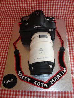 (May 2013) This was my first attempt at making a camera cake. If I had more time I wouldve done a better job. But at least it looks like a camera. Hope you like it. xMCx