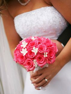 A Classic Bouquet  Since they had a November wedding and there aren't too many flowers that are in season, Kyle stuck with a simple pink rose bouquet. To add a pop of white, she had a few stephanotis placed throughout the bouquet.  Budget Saver: If you're getting married in an off season, ask your florist for a list of best-priced flowers that time of year.
