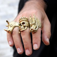 one of these, in not-yellow gold, on the pinkie...otherwise, no.