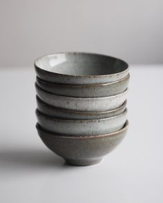 """""""Stacked half pound bowls, each with a crackle glaze altered in colour by a minuscule percentage of iron oxide. All were fired in a laser gas kiln to cone…"""""""